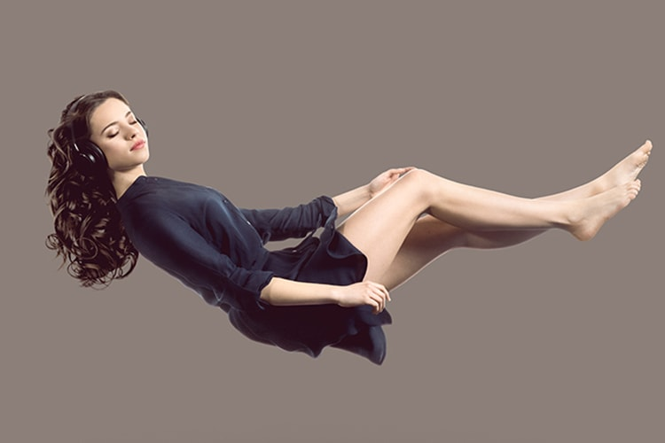 Woman floating in air.